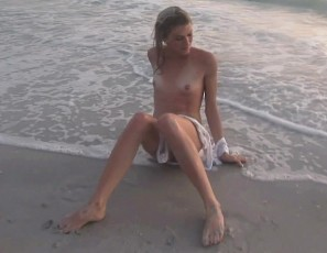content/041815_super_skinny_blonde_playing_naked_in_the_gulf_of_mexico/1.jpg